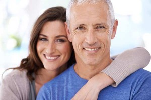 Smiling Couple After Bone Grafting