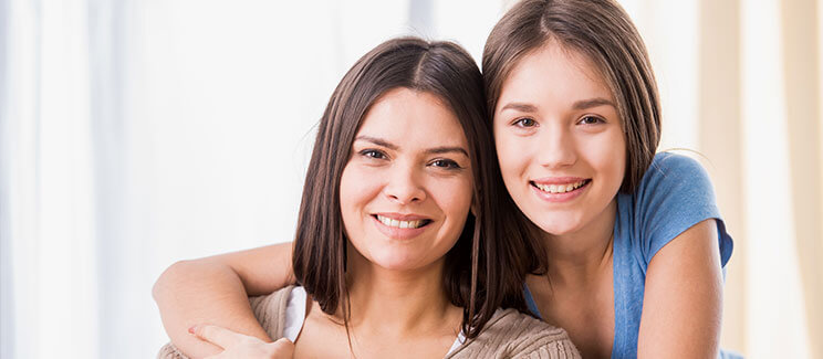portrait photo of mother and daughter, smiling